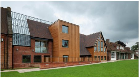 East facing facade of the new music block addition for Aldenham school, featuring multi-stock brick, stained hard-wood timber cladding and solar controlled glazing